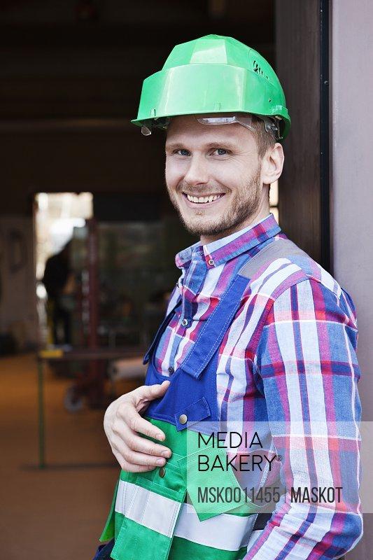 Industrial worker in green helmet