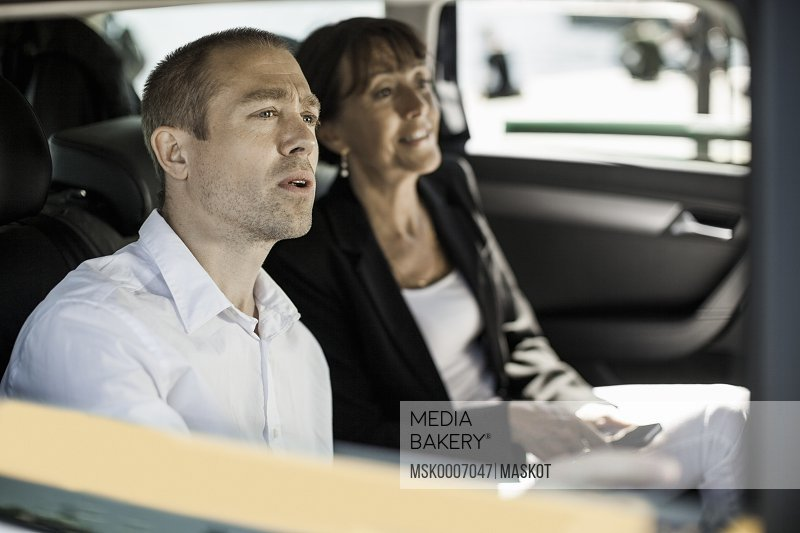 Business people sitting in taxi