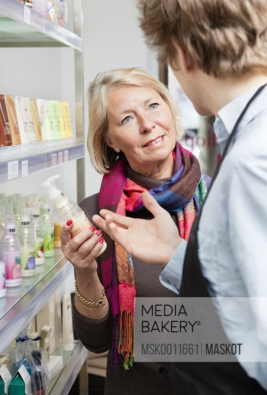 Salesman helping woman