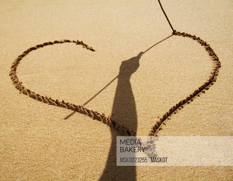 Heart shape symbol drawn sand