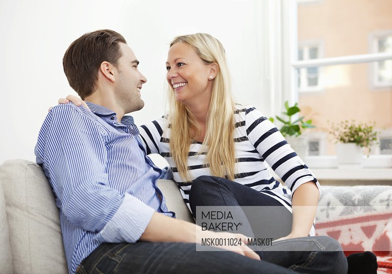Smiling couple in couch