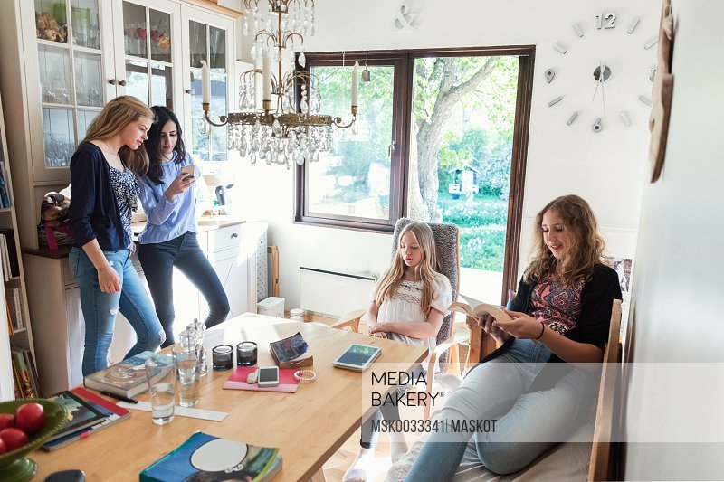 Teenage girls spending leisure time at home