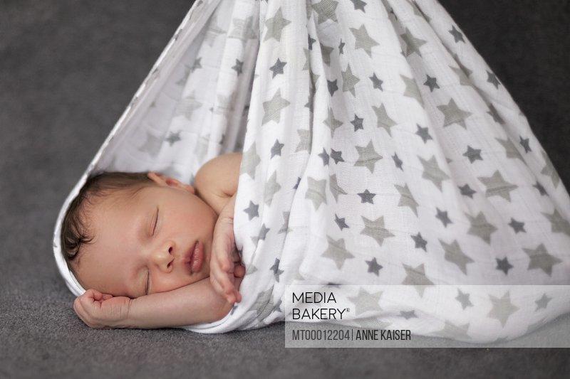 377817cf3 Close-up of cute newborn baby girl sleeping in hammock Furstenfeldbruck  Bavaria Germany