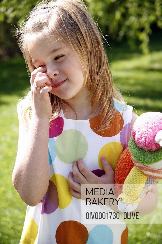 Little girl holding doll
