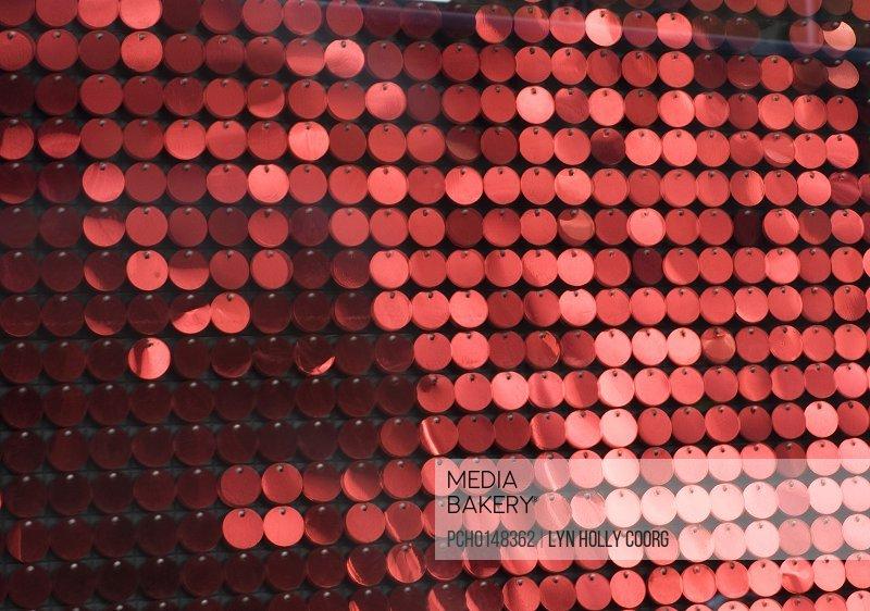 Blurred red metal discs