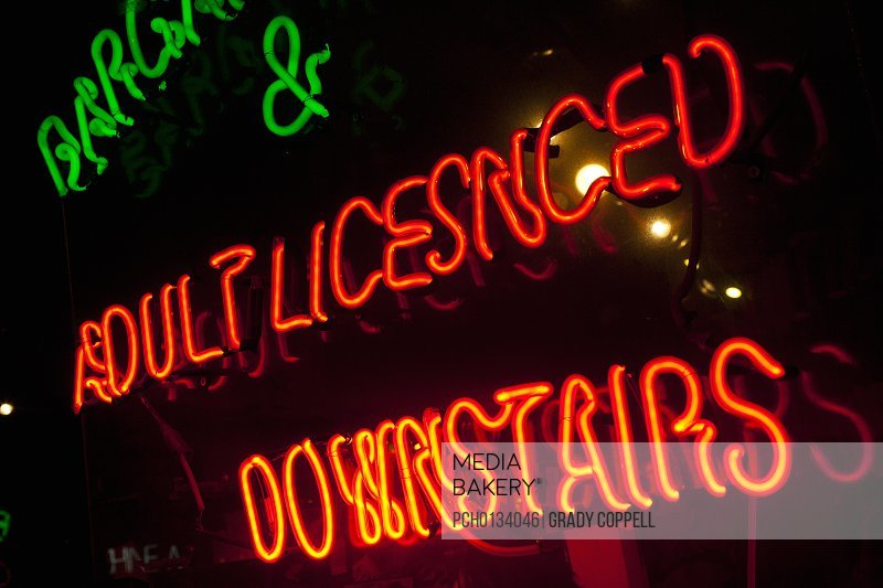 Neon sign offering adult entertainment