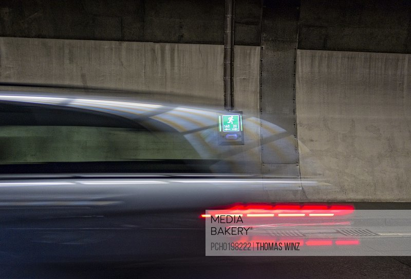 Blurred car and Escape sign
