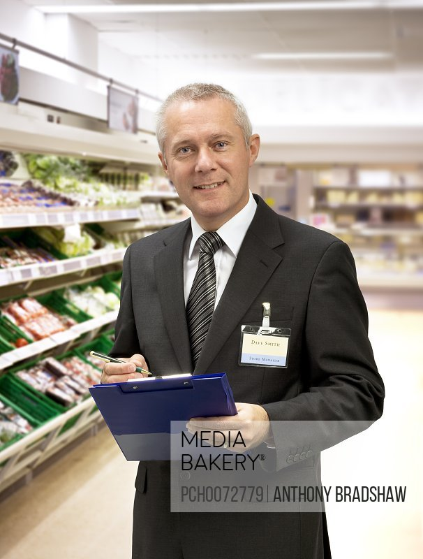 Welcoming supermarket manager