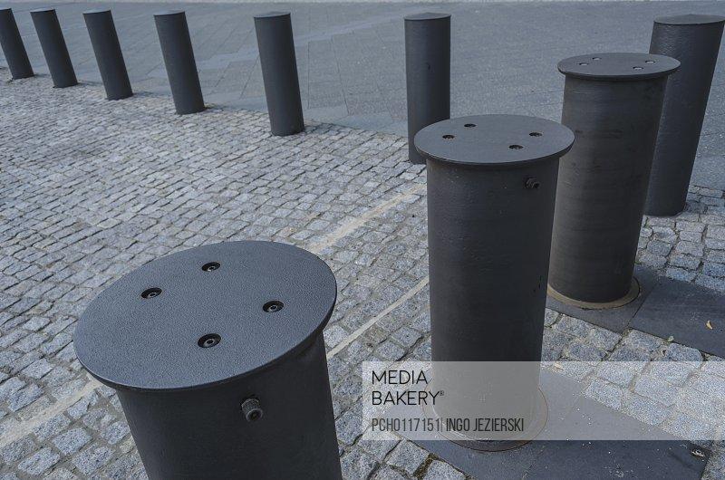 Row of cylindrical pillars blocking access