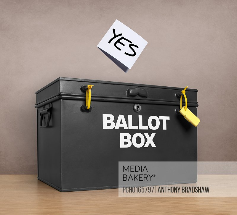 Photo by Photosync Images - YES vote poised above the ballot box