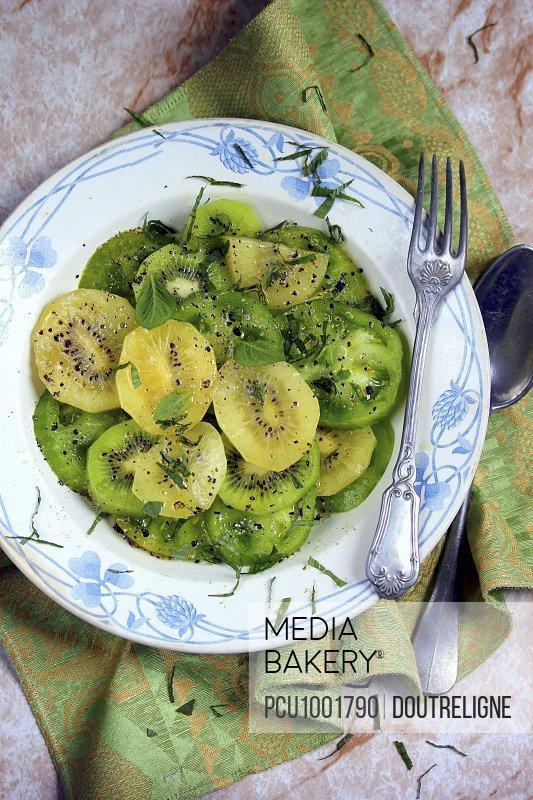 Green tomato and yellow and green kiwis