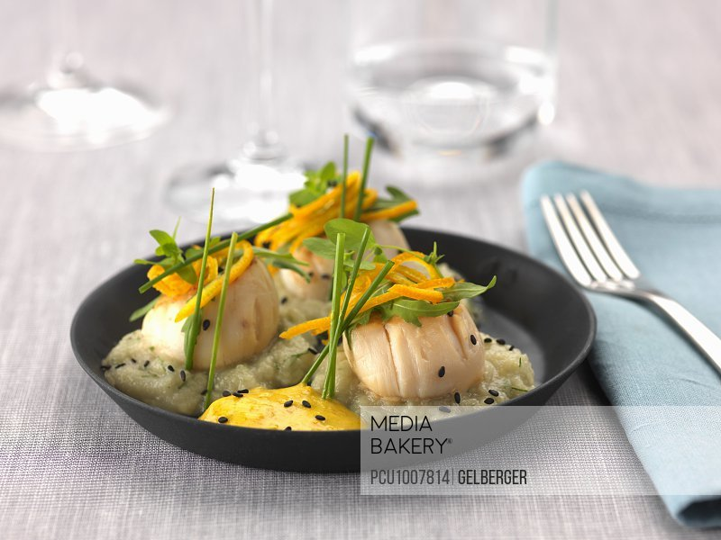 Roasted scallops,rocket lettuce,orange zests and coulis,fennel puree with black sesame