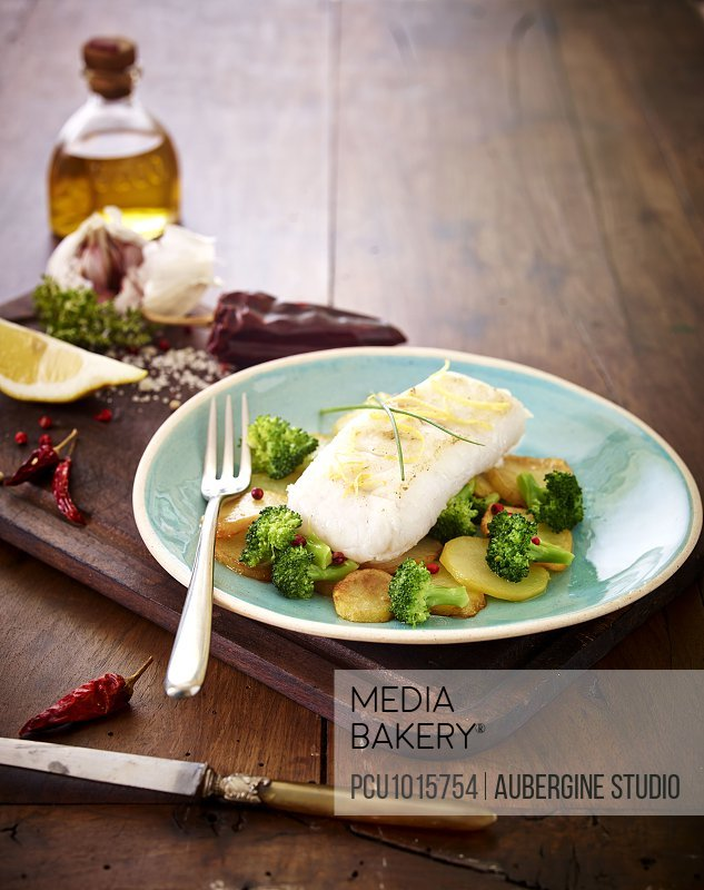 Piece of cod with lemon zests,broccolis and potatoes