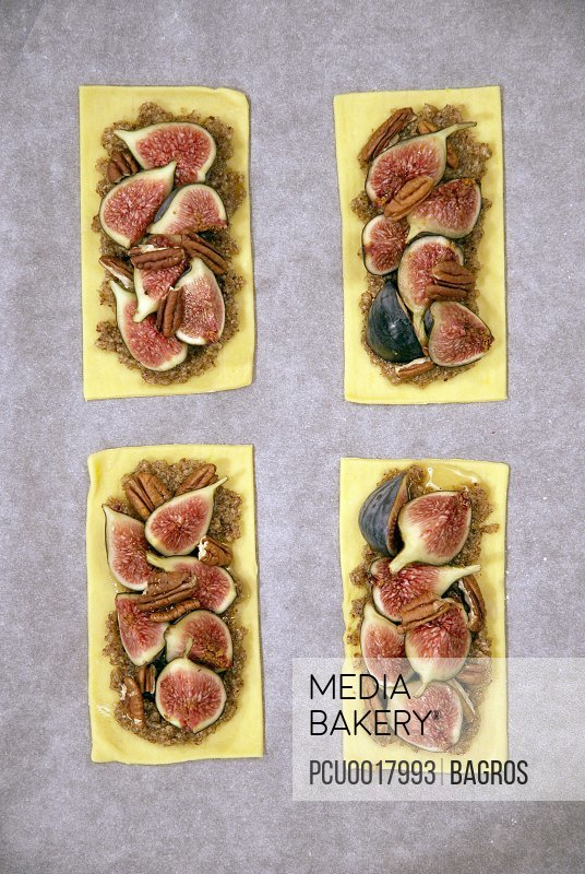 Thin pastry fig tartlets before cooking