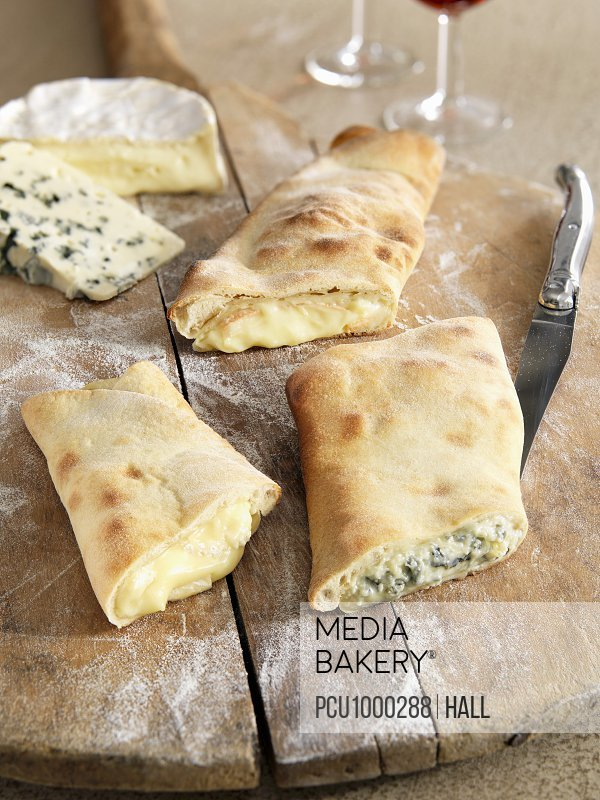 Assortment of cheese pizza turnovers