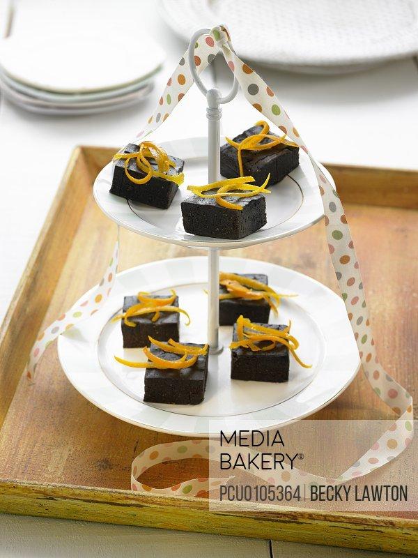 Pieces of chocolate and orange cake