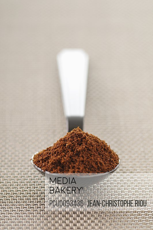 Spoonful of ground coffee