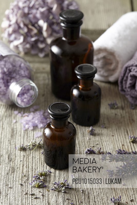 Small bottles of floral scents and bath salts
