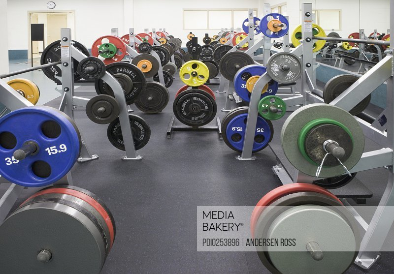Weight benches in gym