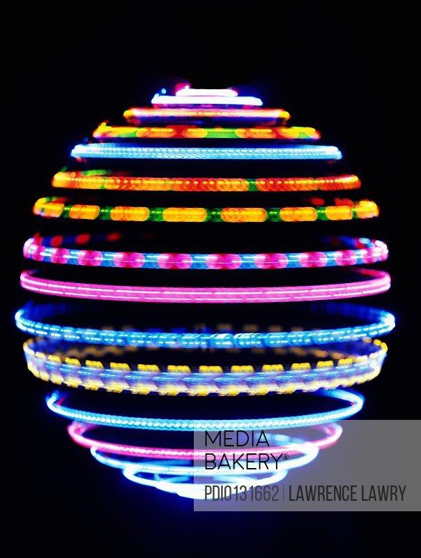 Neon lights forming globe (long exposure)