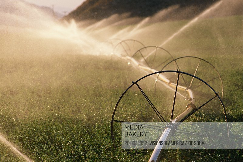 Sprinkler system with wheels watering crops