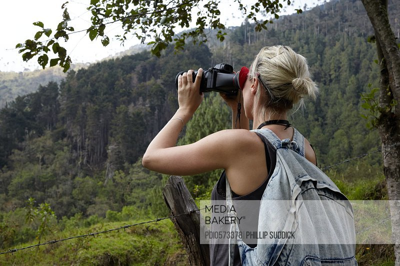 Female Videographer Exploring On Jungle Adventure