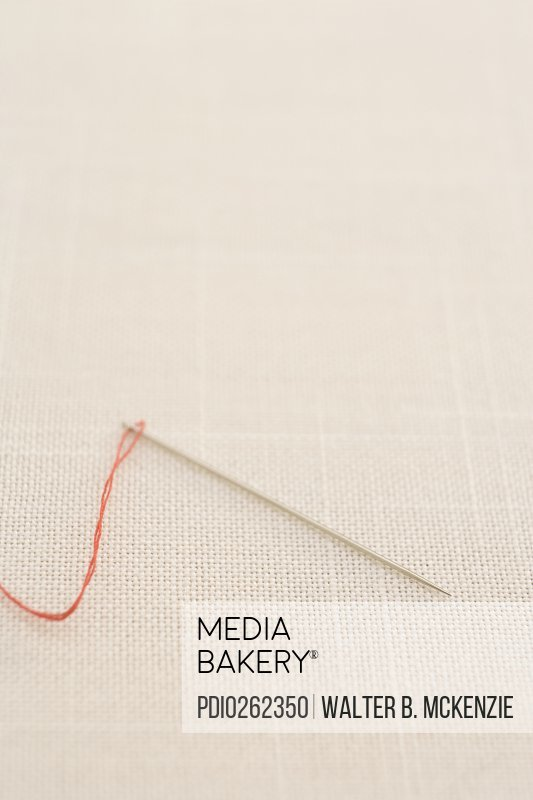 Needle with red thread
