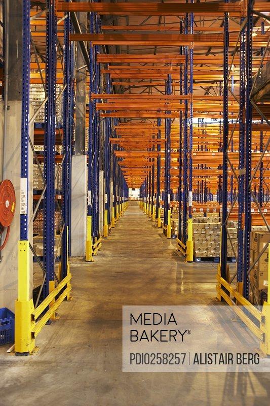 Racks for storing merchandise on pallets in warehouse