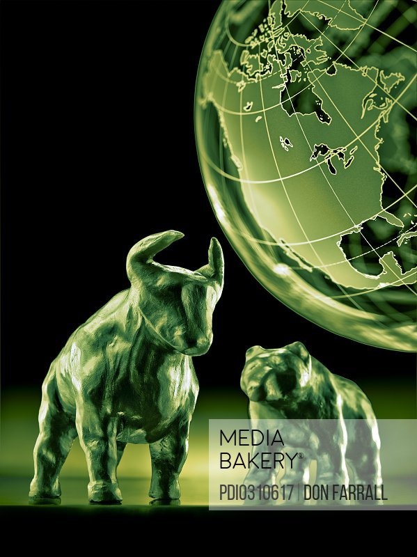 Bear and bull models with globe in background