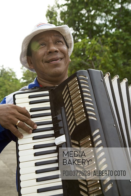 Photo by Photoplay - Latin Man playing accordion
