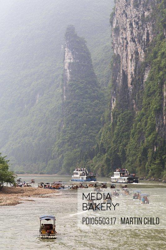Boats on the Li river with karst limestone hills