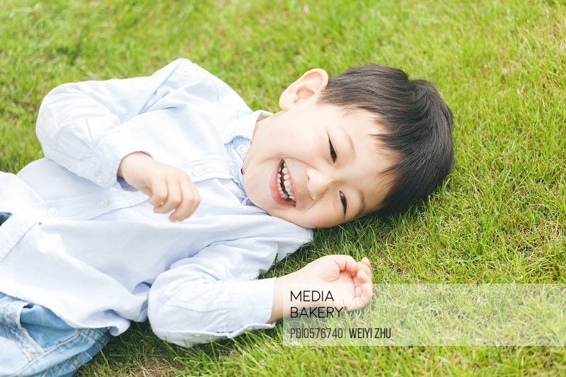 Boy playing on grassland