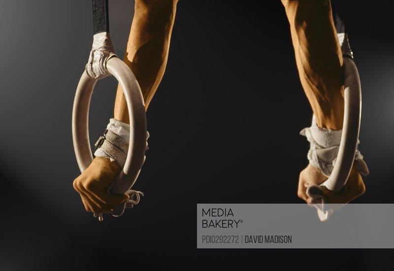 Man balancing on gymnastics rings