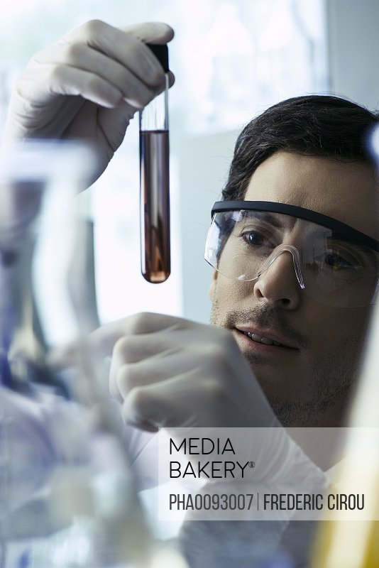Scientist conducting experiment in laboratory