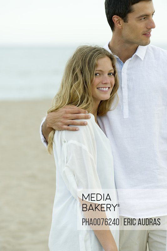 Couple standing together at the beach