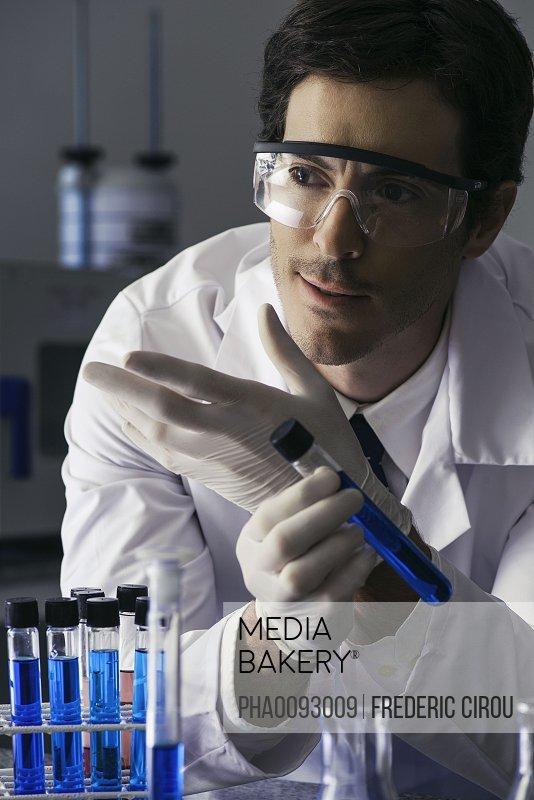 Scientist conducting experiment in lab