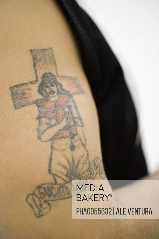 Tattoo of Gauchito Antonio Gil (Little Gaucho Gil) on man's bicep