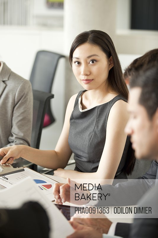 Businesswoman at corporate meeting