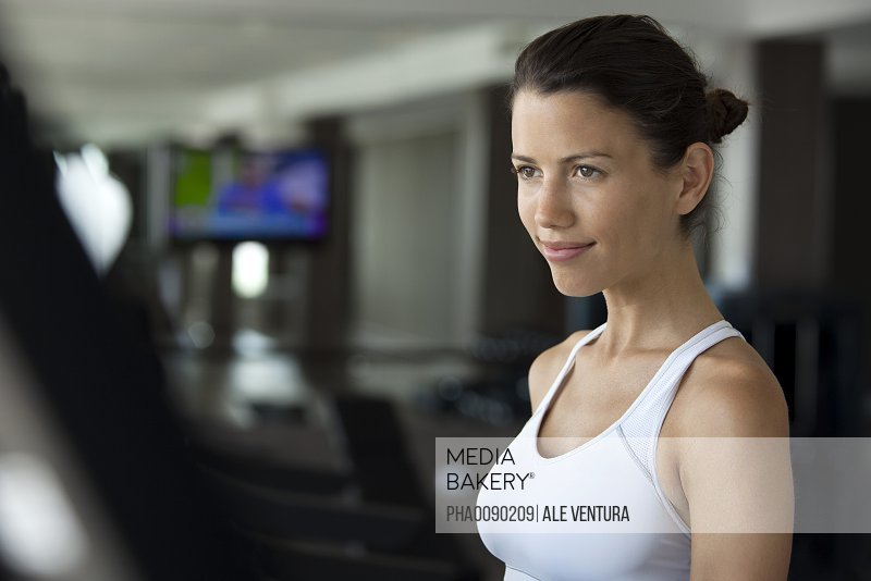 Woman exercising in health club