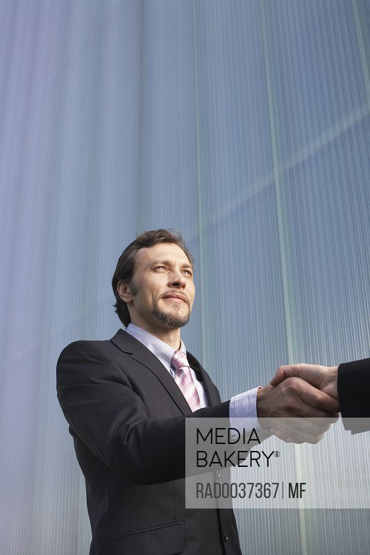 Businesswoman and Businessman Greeting