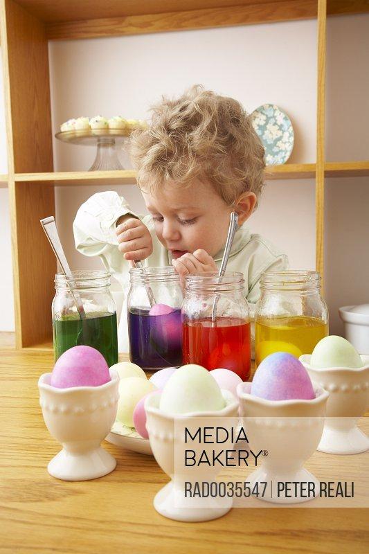 Child Making Easter Eggs