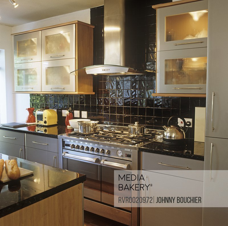 Mediabakery Photo By Red Cover A Modern Kitchen Wood Units Tiled Walls Stainless Steel Oven Extractor Fan Glass Fronted Cabinets