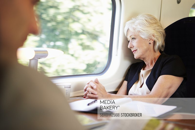 Businesswoman Relaxing On Train Journey