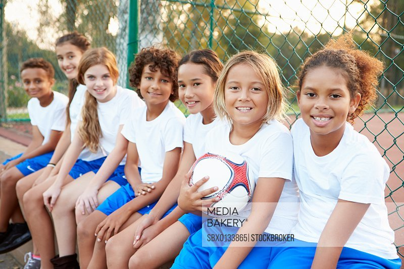 Portrait Of Youth Football Team Training Together