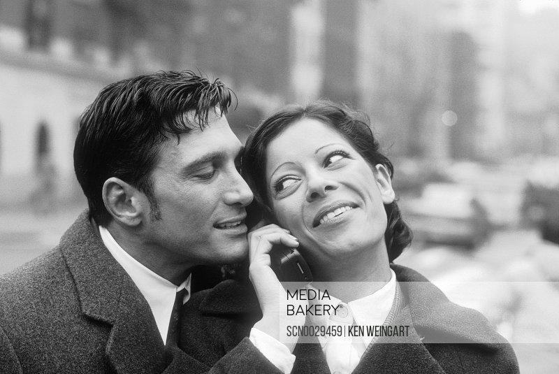 Man caressing woman, smiling