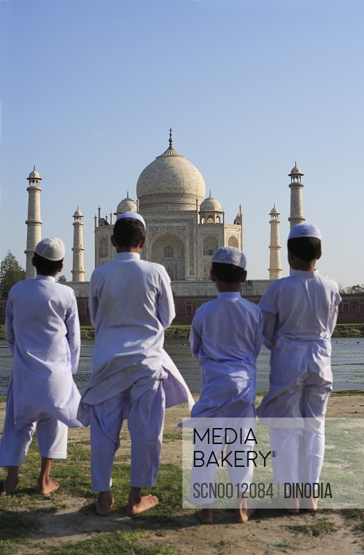 7d801cee6ac1 Young muslim boys performing religious prayer Namaz in front of Taj Mahal  Seventh Wonders of World on south bank of Yamuna river   Agra   Uttar  Pradesh ...
