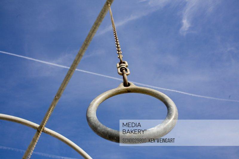 Gymnastic rings against sky