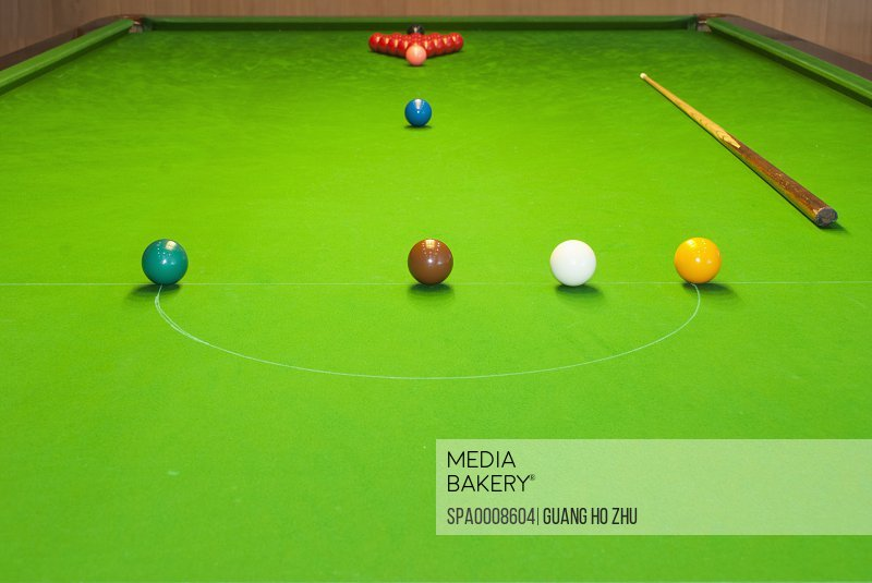 A Collection Of Coloured Game Balls Starting Position Wooden Cue Stick Stock Photo