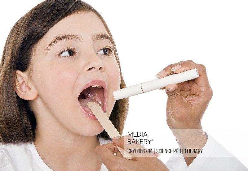 Mediabakery - Photo by PhotoAlto Images - Girl sticking