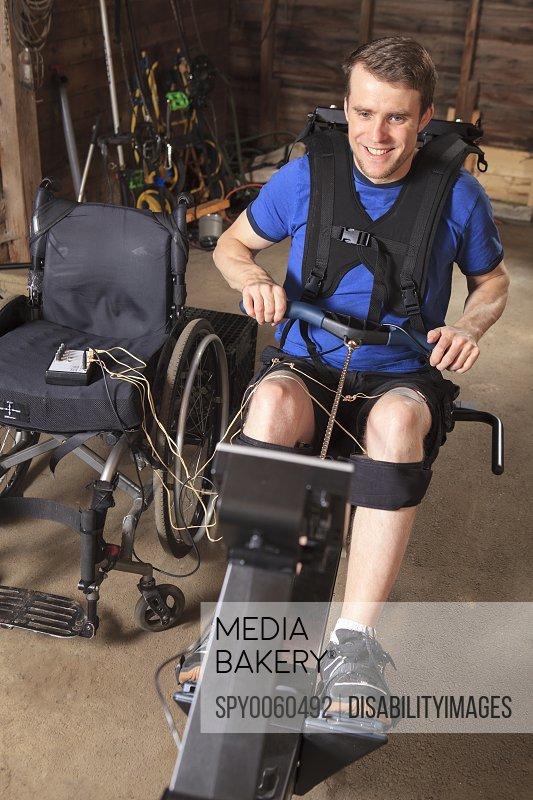 Man in wheelchair using rowing machine